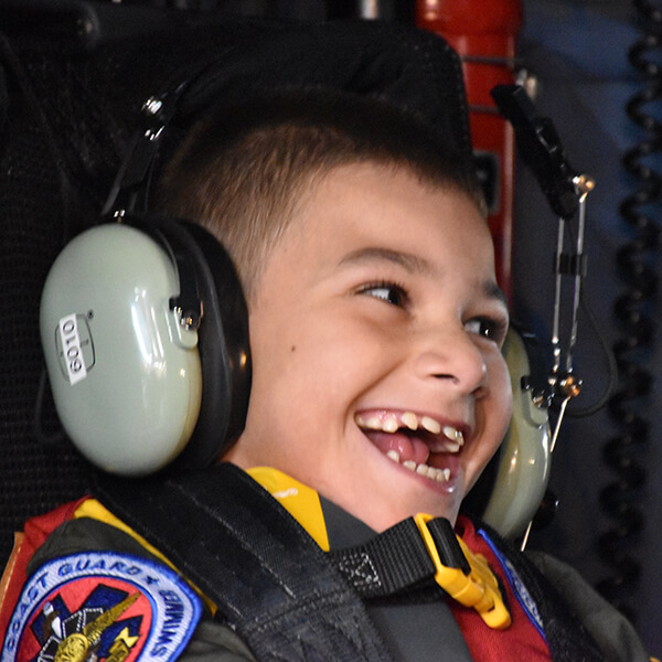 Andrew has the biggest smile on his face in the Coast Guard Rescue helicopter.