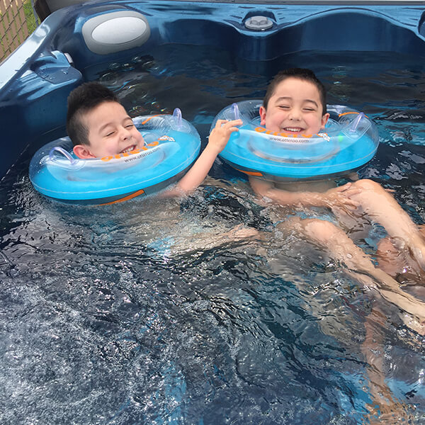 Twin brothers Harper and Hendrix enjoy Harper's wish hot tub.