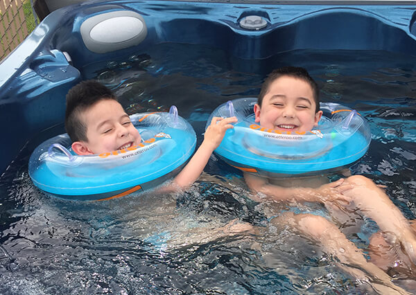 Twin brothers Harper and Hendrix relax in the hot tub Harper wished for.