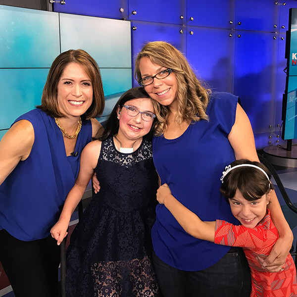 Izzy and her family with KOMO 4 News' Molly Shen.